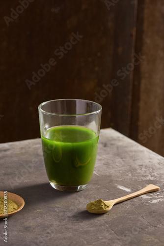 Fototapeta Matcha green tea latte in glass cup