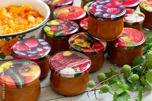 glass jars with apricot jam - 212201778