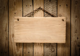 light wood signboard hanging on wooden wall - 212206567