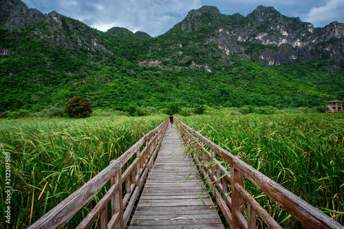 The wooden bridge overlooking the scenery at Sam Roi Yod National Park. It is beautiful and surrounded by nature in Prachuap Khiri Khan, Thailand. - 212207589