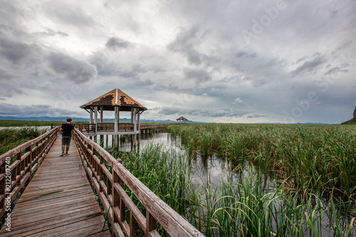 Plexiglas Pier The wooden bridge overlooking the scenery at Sam Roi Yod National Park. It is beautiful and surrounded by nature in Prachuap Khiri Khan, Thailand.