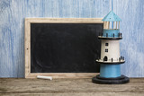 Blank vintage chalkboard with lighthouse - 212216779