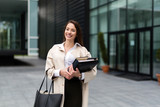 Portrait of young businesswoman going to office - 212223509