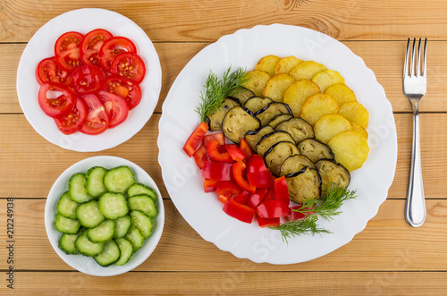 Fried vegetables and sweet pepper, plate with tomatoes and cucumbers - 212249138