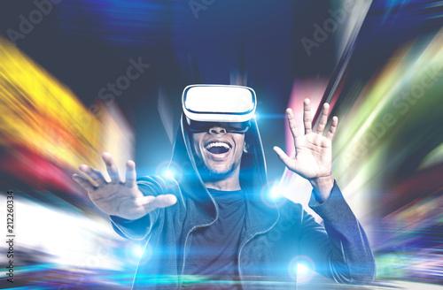 Leinwanddruck Bild Happy African American guy in VR glasses