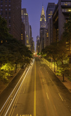 42nd street, Manhattan viewed from Tudor City Overpass at night featuring car light trails on the foreground © TetyanaOhare
