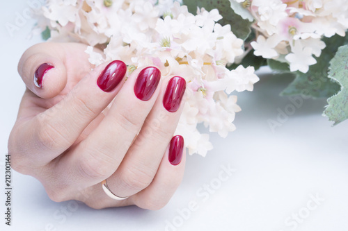 Aluminium Manicure Attractive manicure on women's hands. Natural finger nails with stylish nail art.
