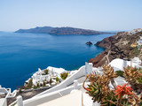 Oia village on Santorini island. Traditional and famous houses and churches with blue domes over the Caldera, Aegean sea. Greece, june 2018 - 212301165