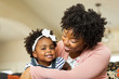 African American family. Mother and daughter smiling at home. - 212305581