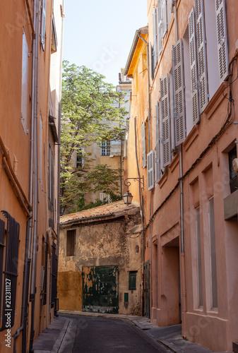 Fototapeta Pastel coloured street in Aix-en-Provence, France