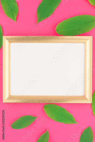 Flat lay with green leaves and frame mockup - 212369328