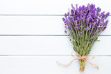 Lavender flowers, bouquet on rustic background, overhead.