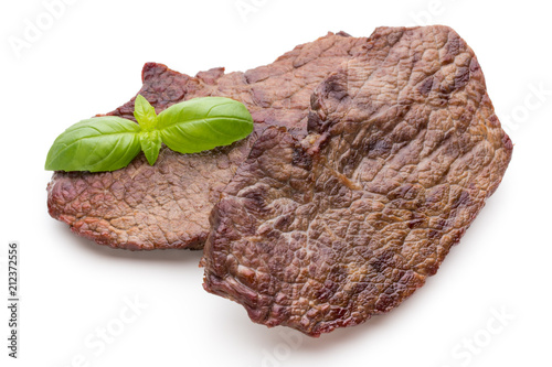 Fotobehang Steakhouse Grilled beef steaks with spices isolated on white background.