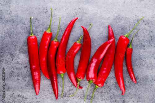 Fotobehang Hot chili peppers Chili cayenne pepper on grey background.