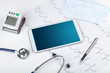 Leinwanddruck Bild - Medicine and modern technology concept with diagnostics concept with free space on tablet screen