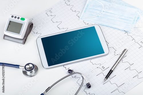 Leinwanddruck Bild Medicine and modern technology concept with diagnostics concept with free space on tablet screen