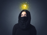 Young muslim woman wearing niqab with yellow question marks above her head - 212382355