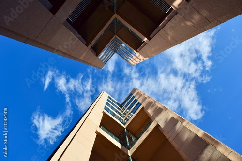 Foto Murales Tall buildings with mirrored windows and blue sky