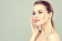 "Постер, картина, фотообои ""Beautiful young woman with clean fresh skin .Girl beauty face care. Facial treatment . Cosmetology , beauty and spa .   """