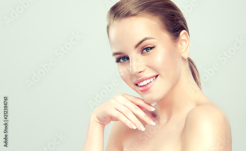 Leinwanddruck Bild Beautiful young woman with clean fresh skin .Girl beauty face care. Facial treatment . Cosmetology , beauty and spa .