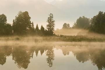 Reflection of lake Matheson early morning, New Zealand natural landscape