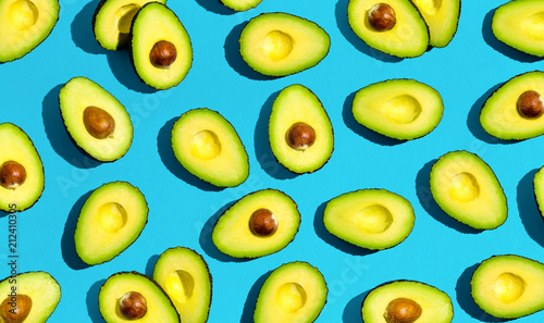 Fresh avocado pattern on a blue background flat lay - 212410305