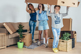 Woman and her daughters moving in new home - 212410912