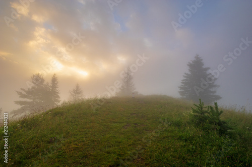 Aluminium Natuur spectacular, fairytale sunset over the mountains, floating mist highlighted by the setting sun, Pieniny, Slovakia