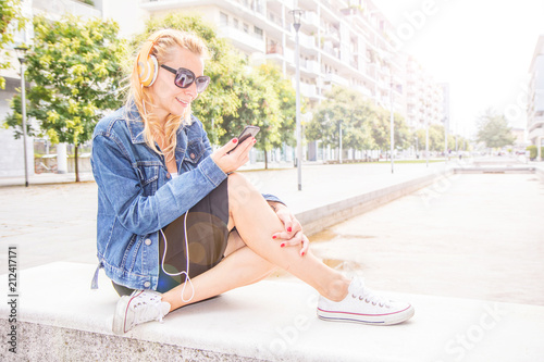 beautiful woman listening music with headphone - 212417171