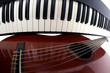 Leinwanddruck Bild -  piano keys and classical guitar close up on white background