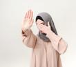 Muslim woman making stop gesture