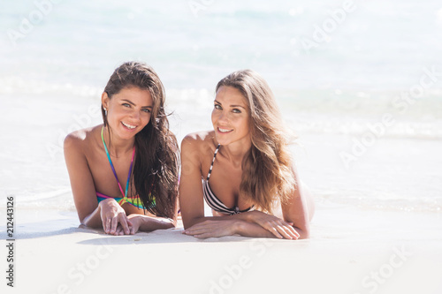 Women laying by sea