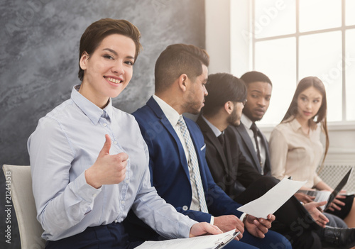 Leinwanddruck Bild Multiracial people waiting in queue preparing for job interview