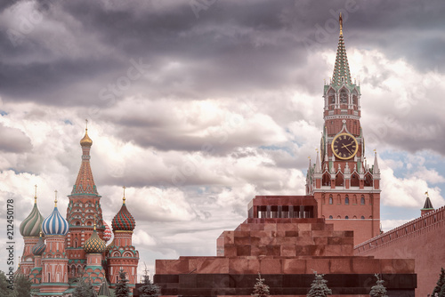 Foto Spatwand Moskou The mausoleum at Red Square, St. Basil's Cathedral, Kremlin Spasskaya Tower, a brick wall of the Kremlin, in a cloudy day.