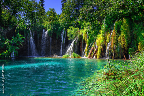 canvas print picture akes with blue water and waterfall.