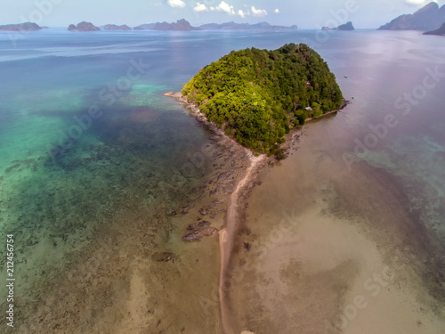 Fotobehang Tropical strand Seascape landscape from the sky. Beach on top. Sea, sand, palm trees.
