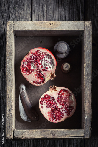 Foto Murales Sweet and juicy pomegranate in a rustic kitchen