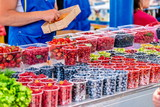 Different coloured berries on sale at a market stall - 212460776