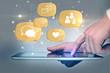 social media icons above digital tablet