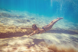 Girl Swimming Under The Sea - 212474583