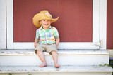 Young Mixed Race Chinese and Caucasian Boy Wearing Cowboy Hat Relaxing On The Steps - 212477930