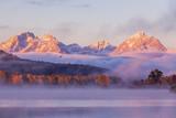 Scenic Sunrise Reflection of the Tetons in Autumn - 212485376