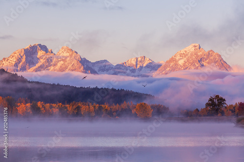 Scenic Sunrise Reflection of the Tetons in Autumn