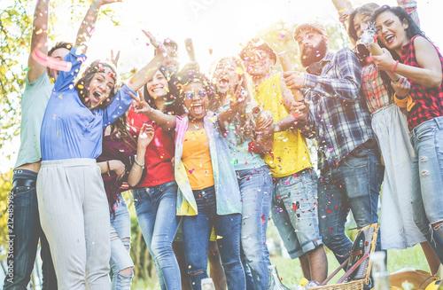 Leinwanddruck Bild Happy friends having party, throwing confetti outdoor