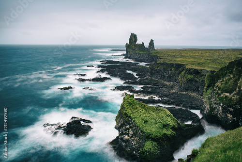 Fotobehang Groen blauw Dramatic scandinavian sea landscape with big cliffs and moody sky. Iceland outdoor travel background. Long exposure