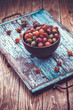 old wooden tray with gooseberry on the table