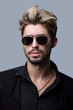Close-up portrait of handsome stylish man in sunglasses. - 212504705