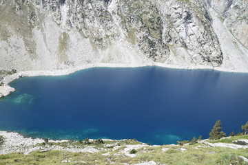 Blue lake in rocky mountains © mikel