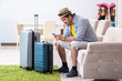 Young family packing for vacation travel