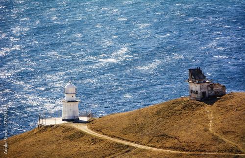 Fotobehang Vuurtoren Lighthouse and abandoned radio-transmission near the lighthouse, Cape Meganom. City district Sudak, the Republic of Crimea.